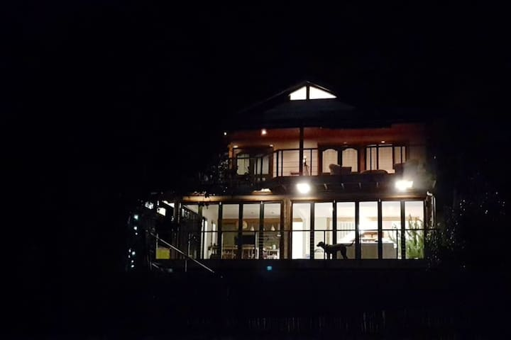 The front view of the house by night
