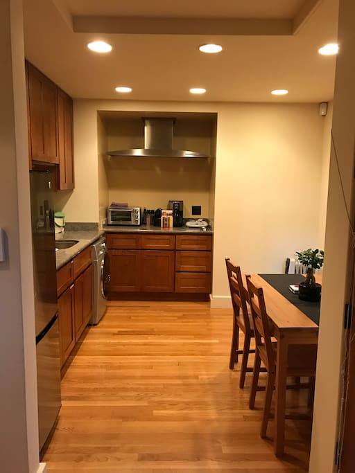 Fully stocked kitchen, equipped with 2 induction burners, toaster oven, Nespresso Coffee maker, refrigerator, microwave, and a dual washer/dryer!