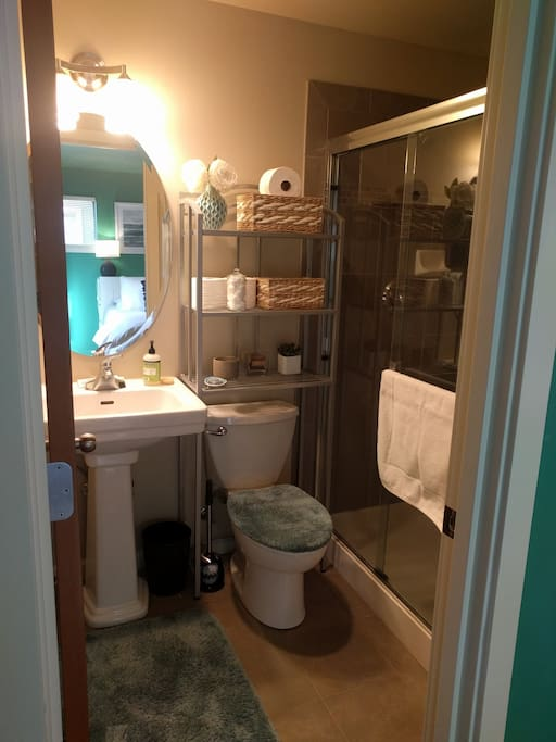 Bathroom with stand up shower. Soap, toothpaste, floss, shampoo supplied.
