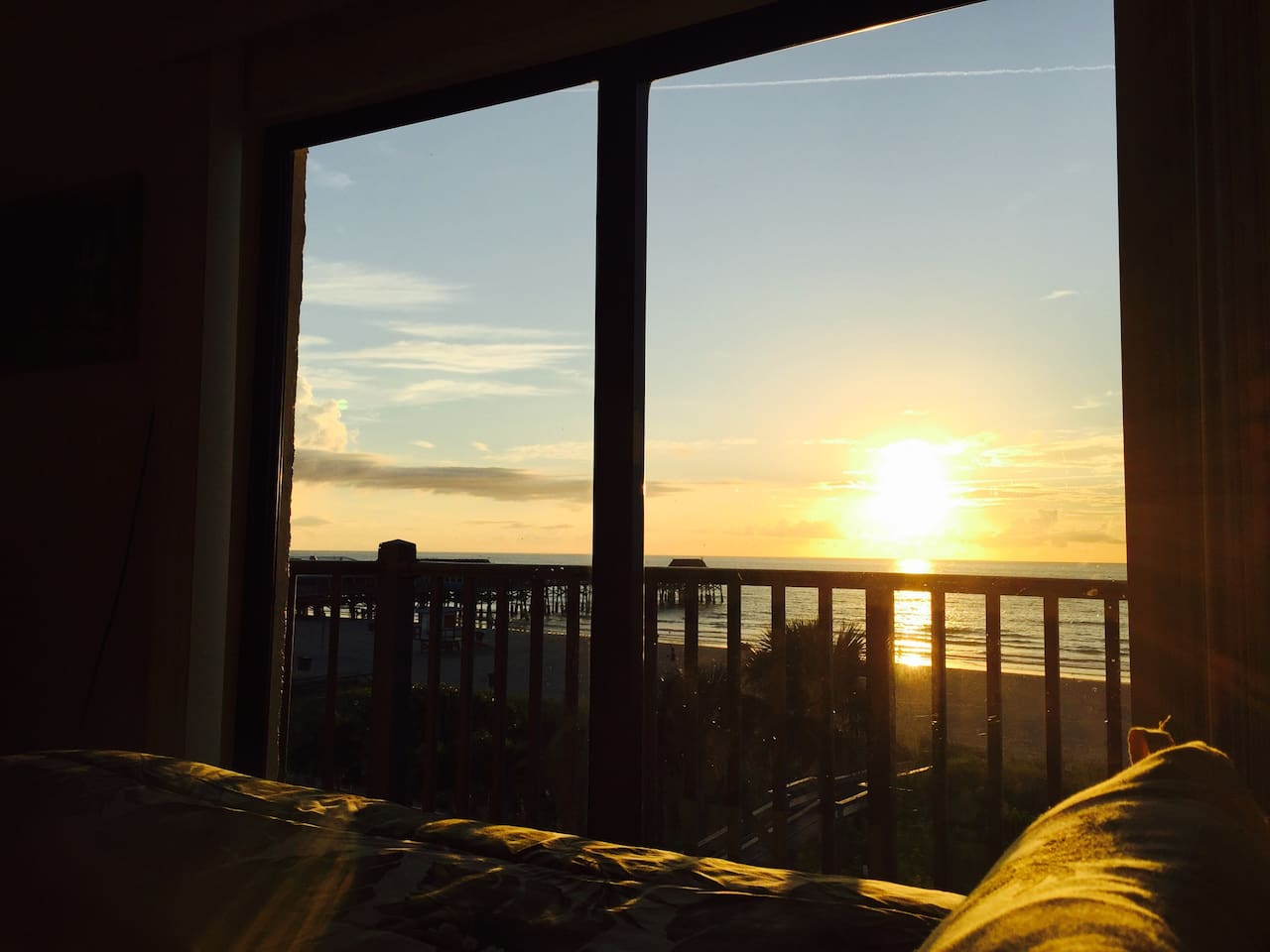 sunrise view from your kingsize bed in master bedroom