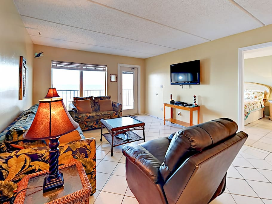 The open living area features a flat screen TV with a DVD player. Complimentary Wi-Fi provided.