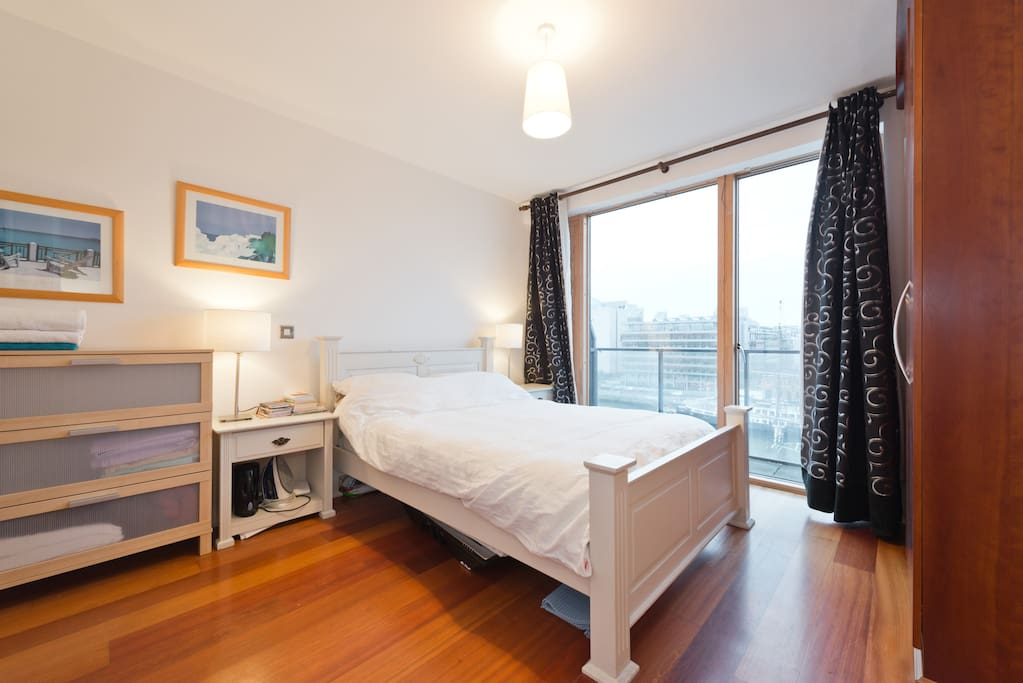 Specious master bedroom with direct access to balcony and liffey views