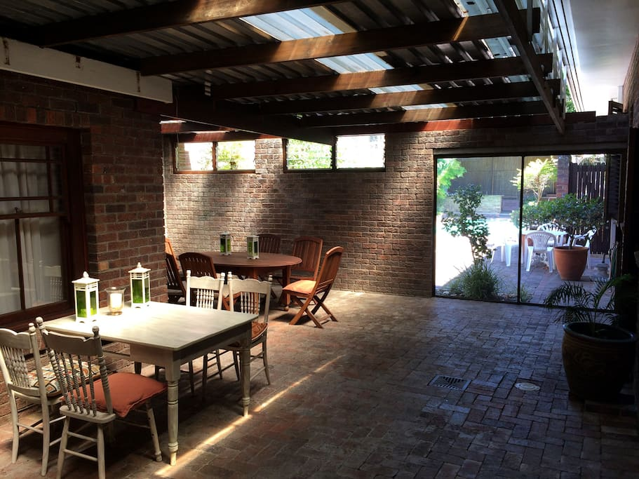 Undercover patio area with seating plus gas braai.