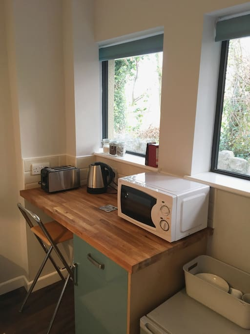 Kitchenette facilities and desk area