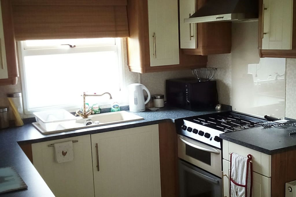Kitchen. Fully functional and well equipped. Breakfast provided. Extra food and drinks available.