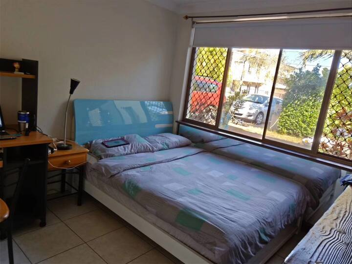 A) aircondition Comfy extra firm Queen bed bedroom