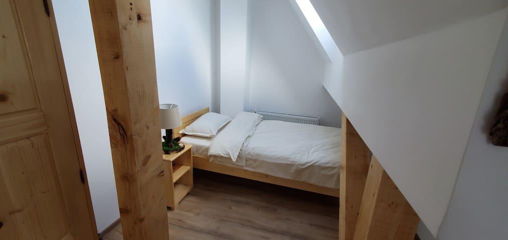 Single bed in the mansard bedroom