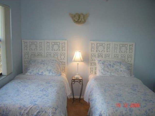 Single beds in second bedroom.