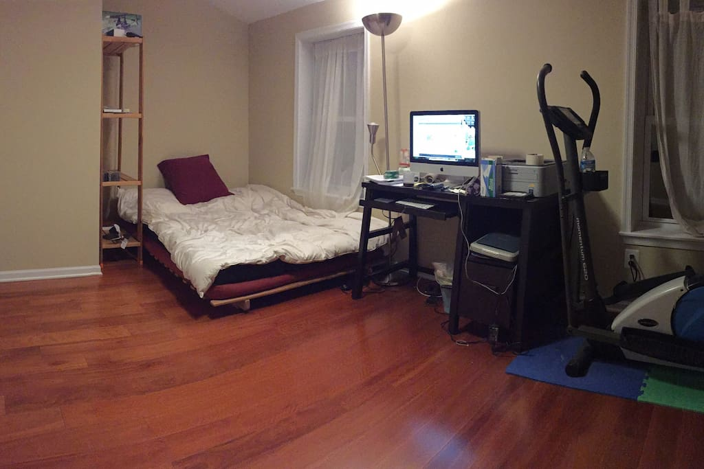 Nice bed, computer and an elliptical