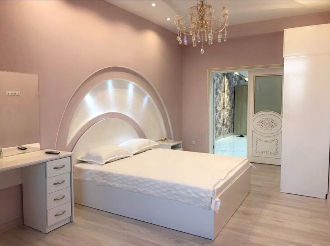 Beautiful bright bedroom. The bed has a medical mattress, it's gives you a good and comfort sleep. Curtains are available Incase if you don't want the light. Also a good size wardrobe and dressing table are available for you. The pillows, bed sheets and bed covers are from a quality brand. Everything for your Comfort ) ).