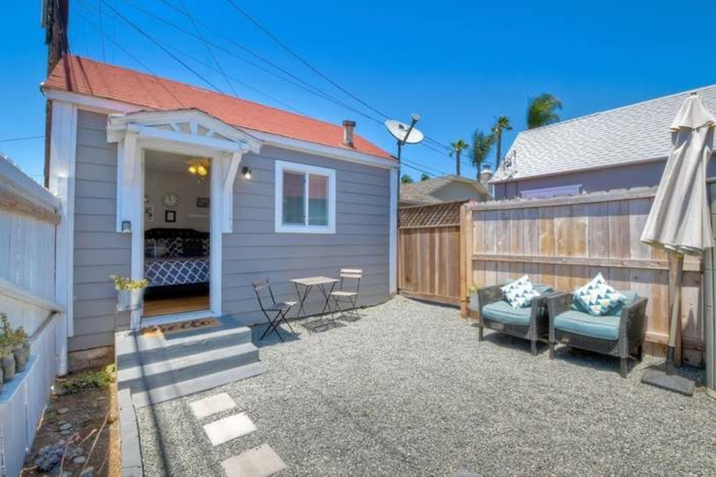 Private courtyard entrance with seating areas for relaxing and enjoying the sea breeze. Secure and gated for privacy and safe storage of surfboards or bikes