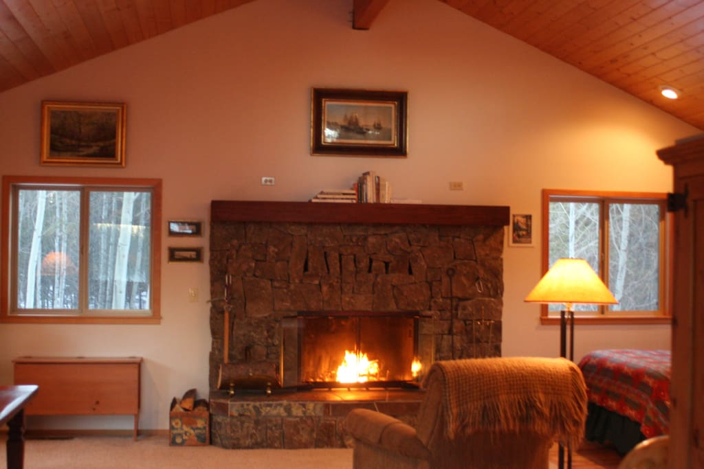 Large rock fireplace with wood provided