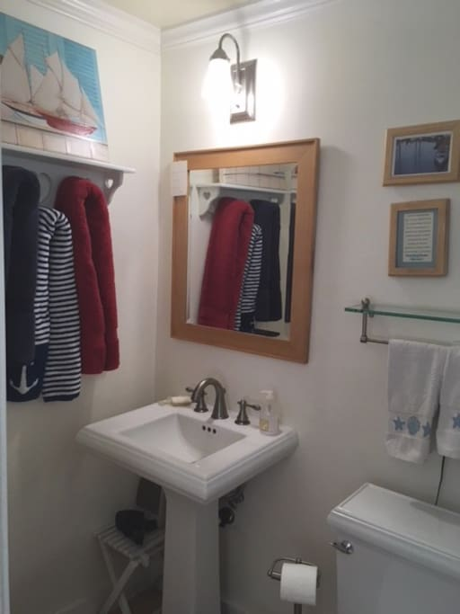 The bathroom, with a large, step-in tiled shower on the right