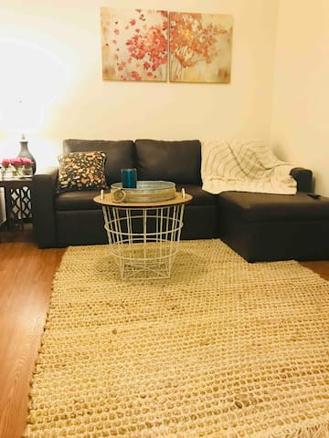 Living room has ample space for guest to relax after a busy day enjoying all that Pensacola has to offer.  Sofa also converts to a full size bed if needed.
