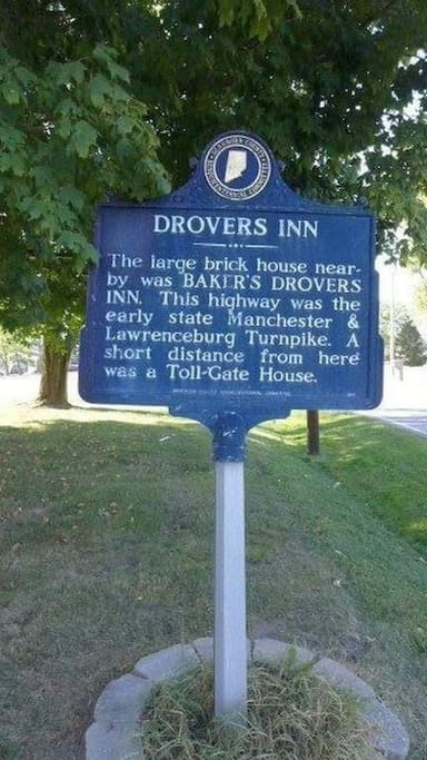 Historic marker in front of the house noting the toll house permitting entrance to the route the home is located on.