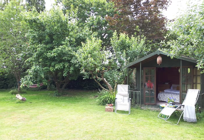 Apple lodge with hammock in your own slice of garden.