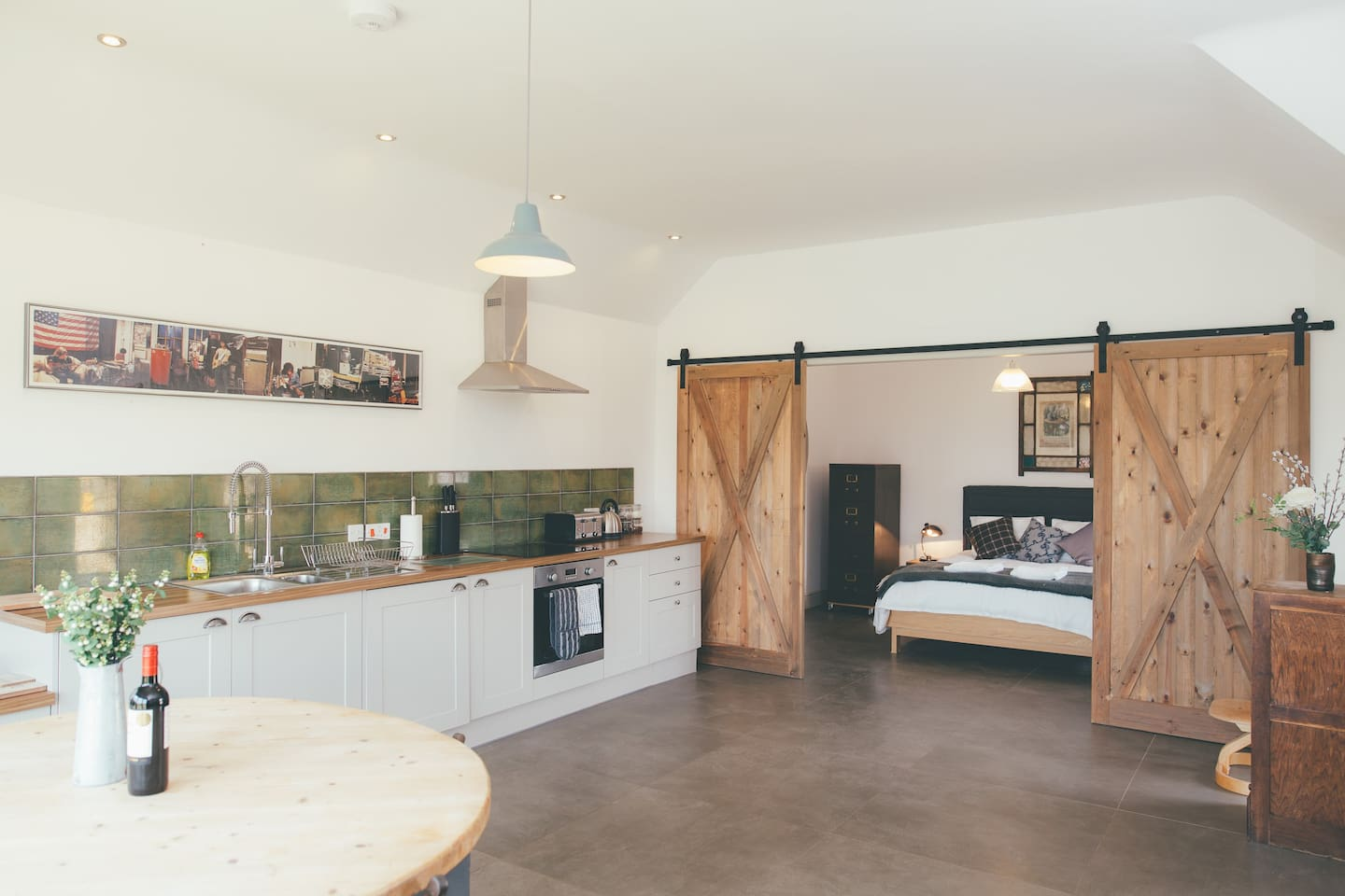 The kitchen and master bedroom in Alice Barn with bespoke barn doors