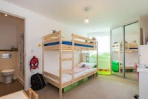 The second bedroom, with adult-sized bunk beds