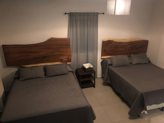 Room 3, beds and nightstand