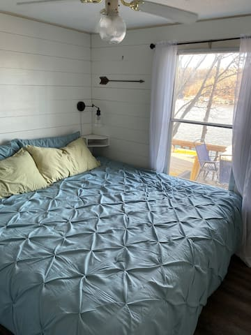 Master Bedroom has King Bed, limited walking space, closet with extra sheets and plenty of space for luggage, hanging space. Beautiful lake view.