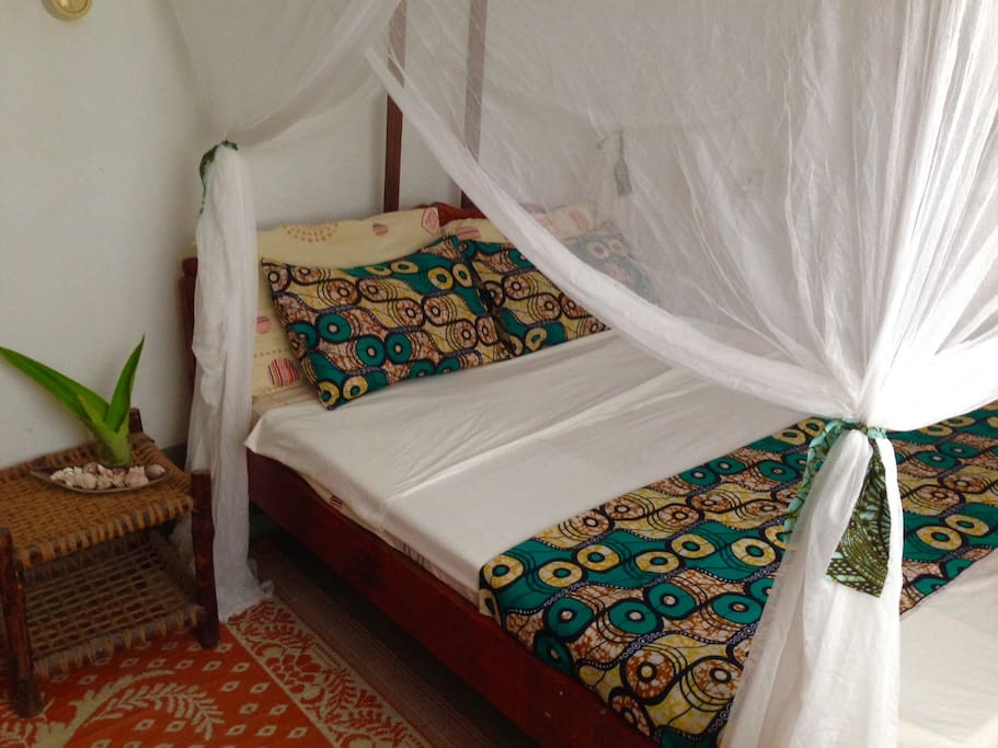 Bedroom 1: cozy doublebed, mosquitoned, fan and wardrobe