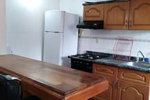 Kitchen includes a refrigerator & stove with oven