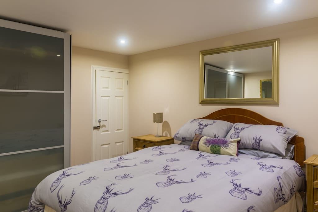 Bedroom with king size bed and double wardrobe