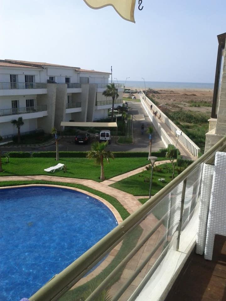 Appartement de vacance pied dans l'eau avecpiscine