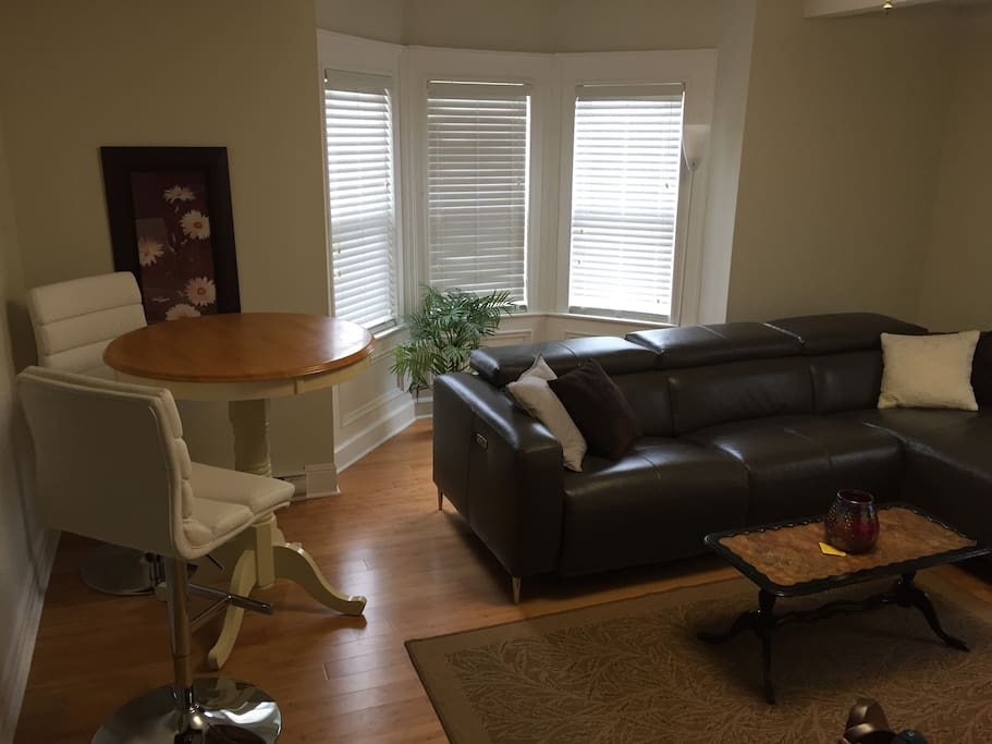 Living room with reclining sofa.
