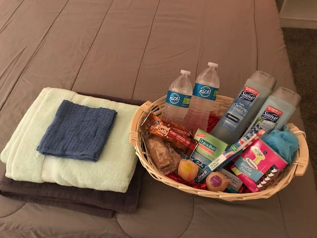 Snacks, water, toiletries, clean towels, and bath bombs