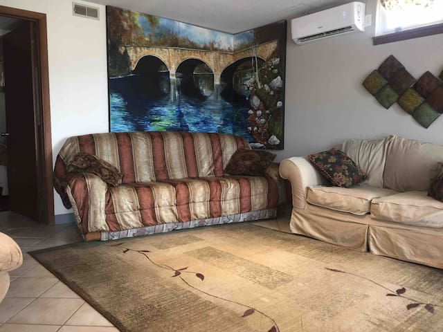 Open living room to dining room. HDTV with antenna & cable, wi-fi. Bring your Netflix code. Exits to patio/parking/backyard.