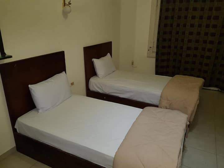 Budget 2 single beds private room Shared Bathroom.