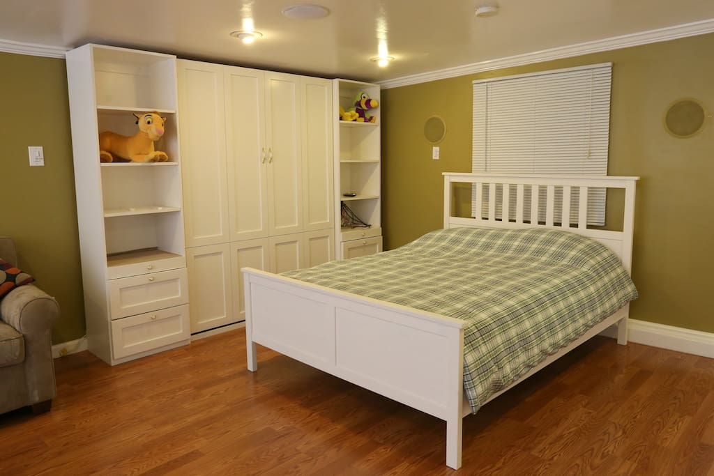 Queen size bed in large bedroom