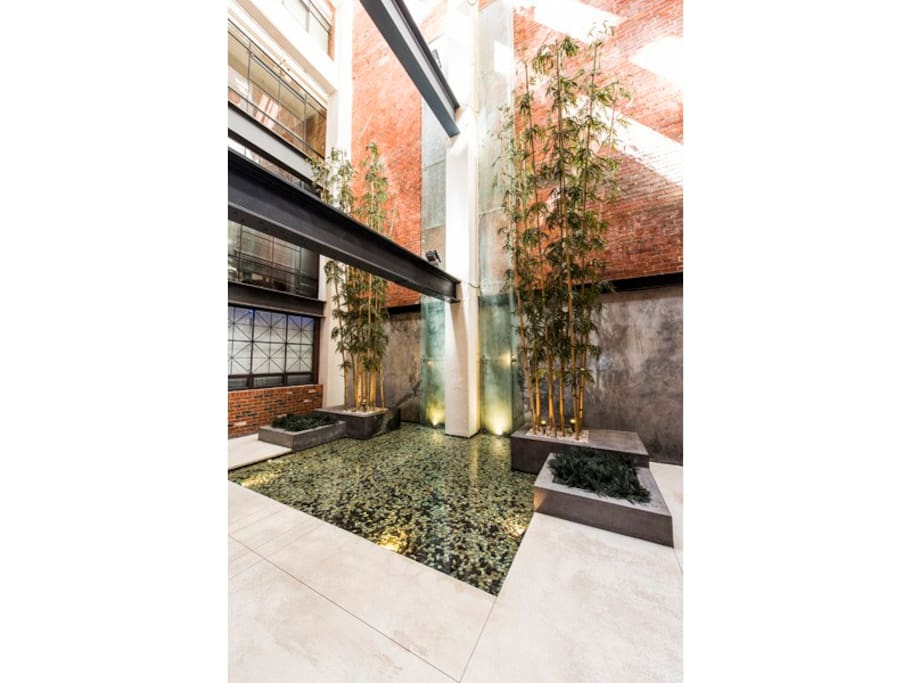 Foyer water fountain with relaxing sounds heard throughout building
