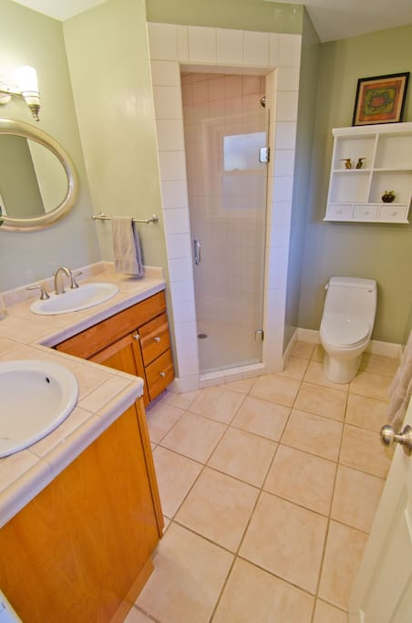 Master bath; two sinks, stand up shower, toilet