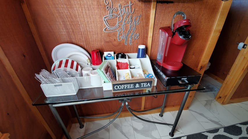 Keurig station with coffee, tea and hot chocolate.  Other items possibly needed