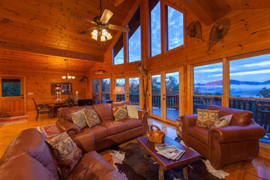 The Great Room featuring Stunning Window Wall Overlooking the Mountains in the Distance
