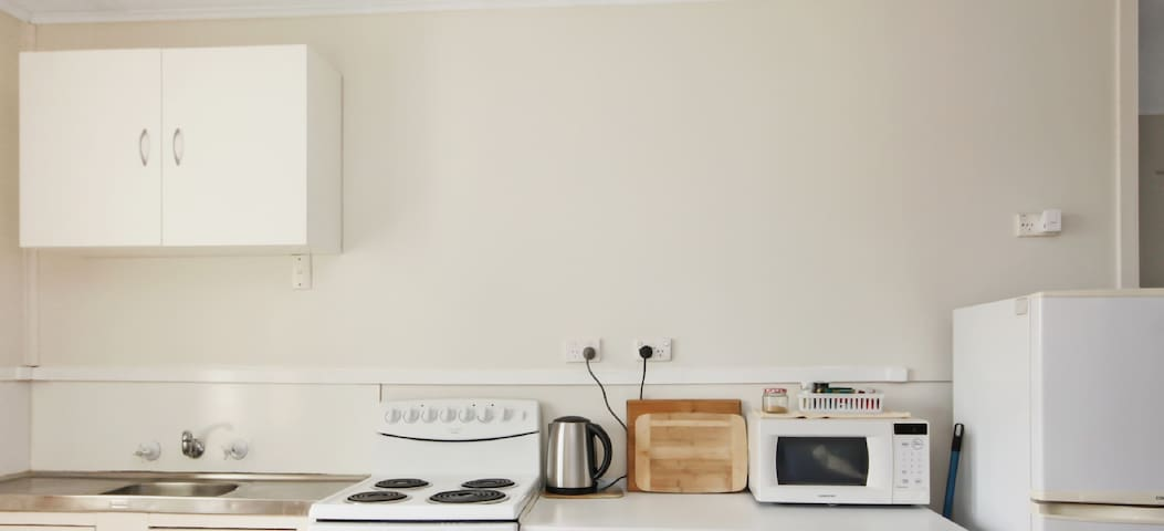Full kitchen with sink, storage, microwave, electric oven, hot plates and full size fridge. ** Please note we have 2 x two bedroom units and we have included photos of BOTH in this listing **