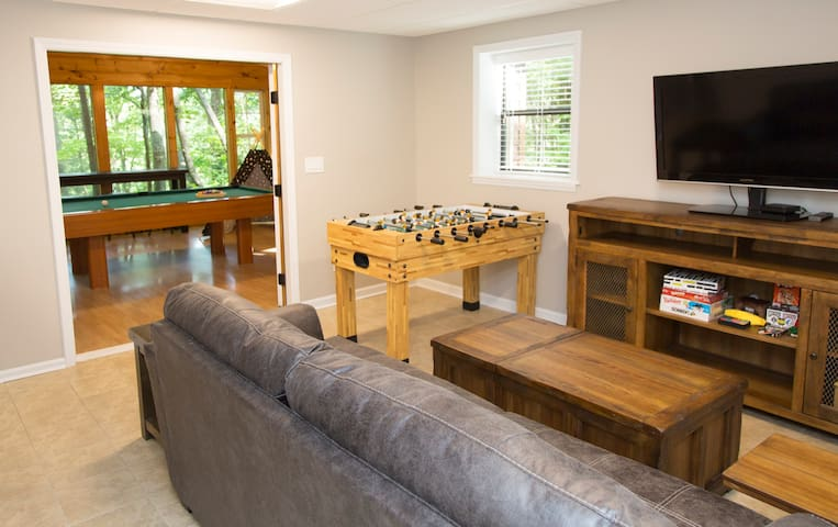 Billiard room with wooded outlook. Board games and foosball. Cable TV and a sleeper sofa.