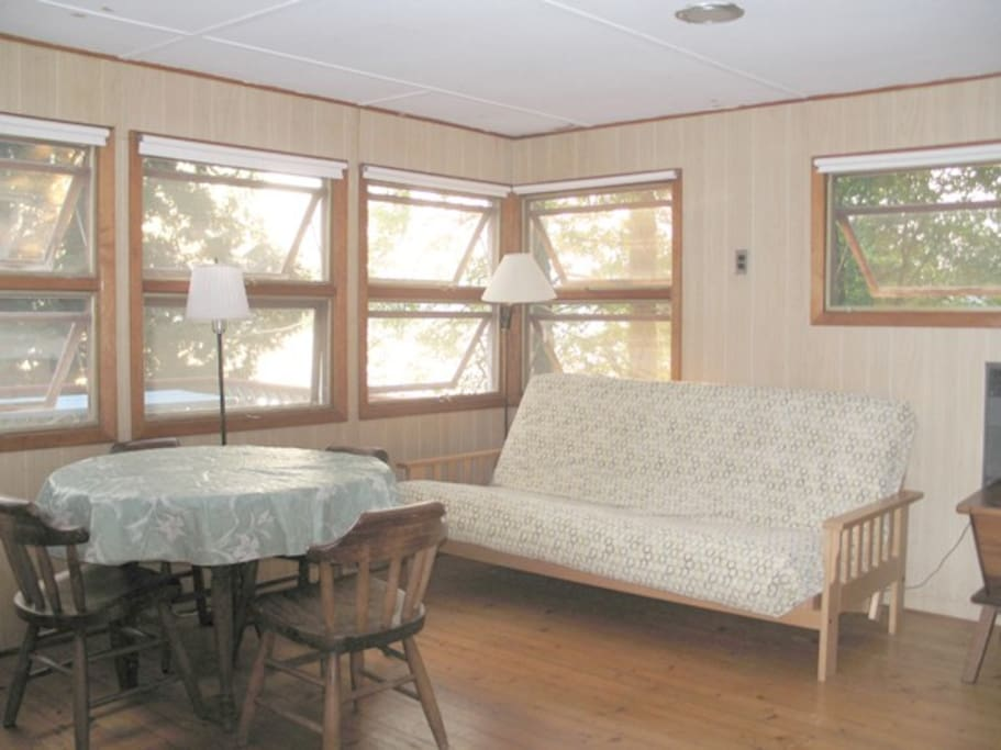 Large main room, with queen size futon. Windows overlook the deck and lake.