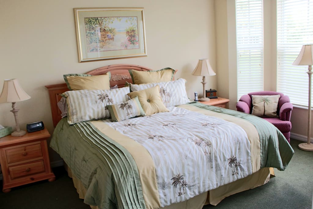 Spacious master bedroom suite with king bed