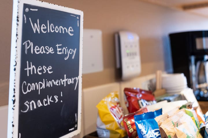 Guests enjoy a welcome basket with tasty snacks, and a fully stocked coffee & tea station.