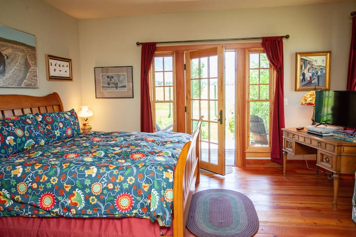 Master suite with private deck, king size bed.