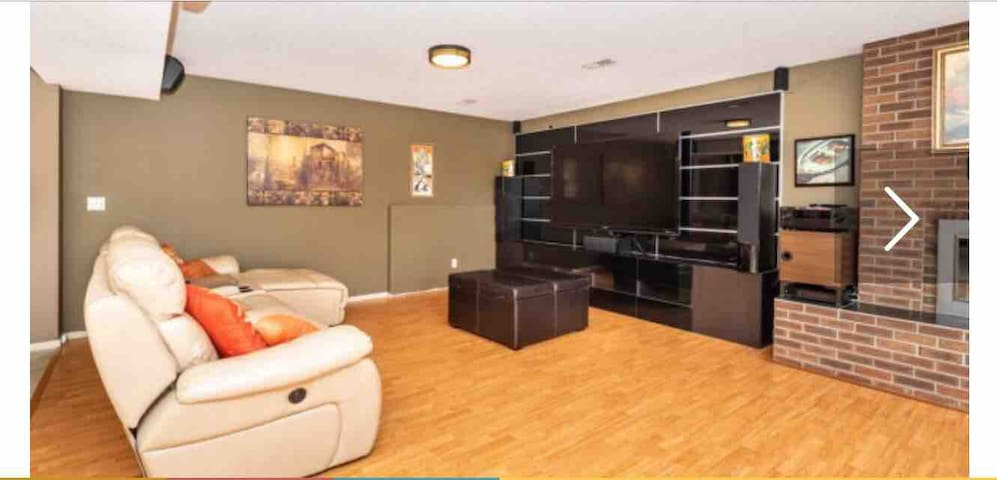 """Bonus room where we set up extra beds if needed. Otherwise it boasts a large 80"""" TV and Netflix option if you have an account!"""