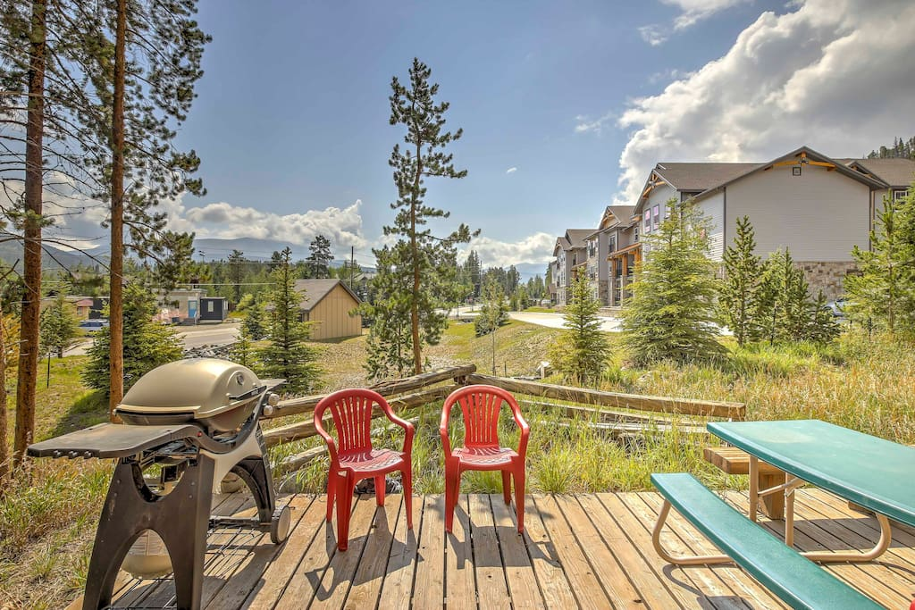 The condo has a private deck with a picnic table, chairs, gas grill and mountain views!
