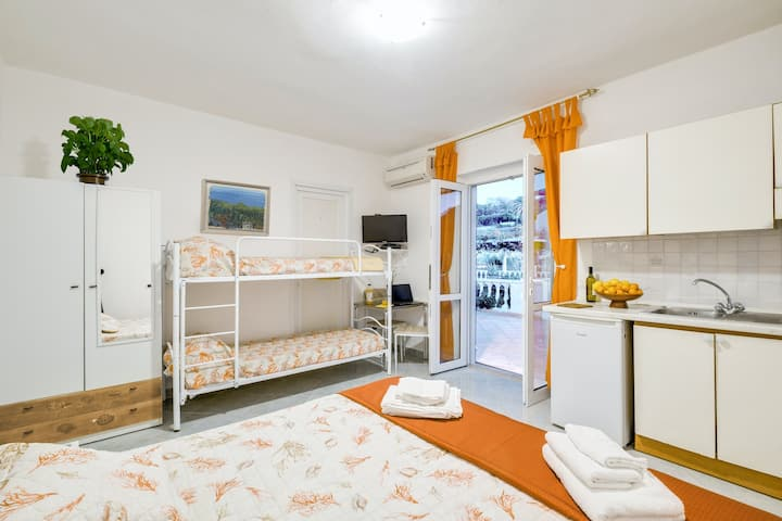 Sunny, kid-friendly studio w/ a kitchenette, free WiFi, & shared terrace w/ view