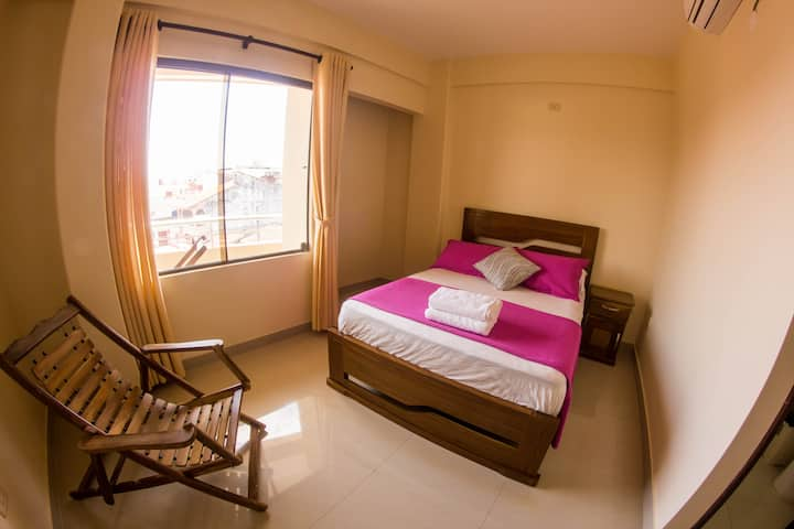 Comfortable Room with AC and 360° Rooftop Patio