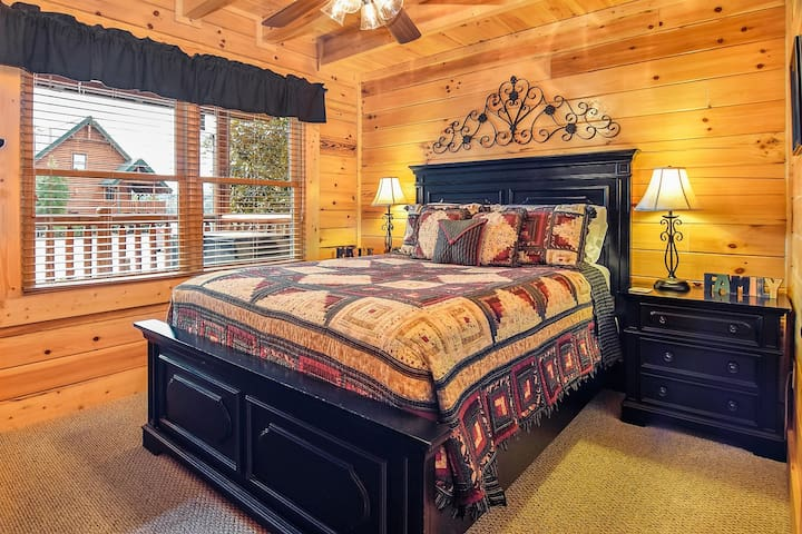 The 2nd bedroom with a queen bed and HD TV