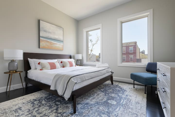 The second bedroom, with its king-size bed, promises a luxurious sleeping experience.
