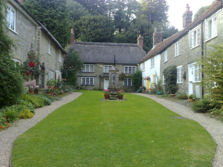 Gated courtyard of cottages, ours shown on left